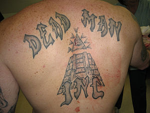 English: Dead Man Incorporated tattoo.
