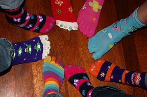 Eight girls wearing toe socks
