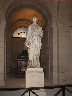 Voltaire's statue and tomb in the crypt of the...