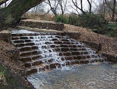 English: Kinson Common Water fall. The man mad...