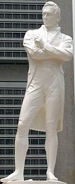 Wit standbeeld van Sir Stamford Raffles-status