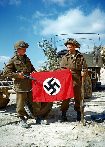 These two Canadian soldiers raise a Nazi flag ...