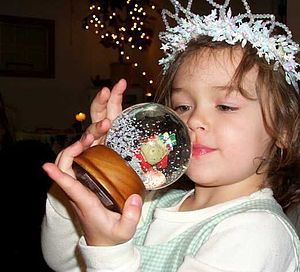 Girl with a snow globe