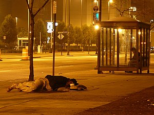 A homeless person sleeping on a street in Cleveland...