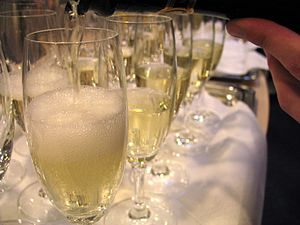 A flight of sparkling wine being poured in Ger...