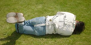 A straitjacket as seen from the rear.