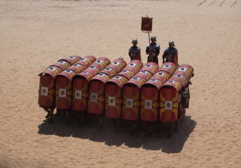 The testudo formation in a Roman military reenactment.