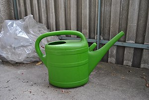 a green plastic watering can