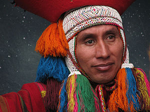 English: A Cuzco native participates in a live...