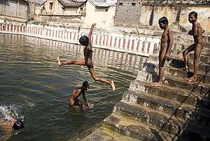 Boys skinny dipping in a sacred tank in Tiruva...