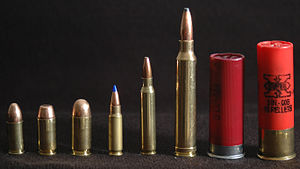 This is a line-up of pistol and rifle cartridg...