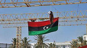 English: An effigy of Moammar Gadhafi hangs fr...