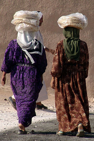 Kurdish women carrying bread home from the sou...