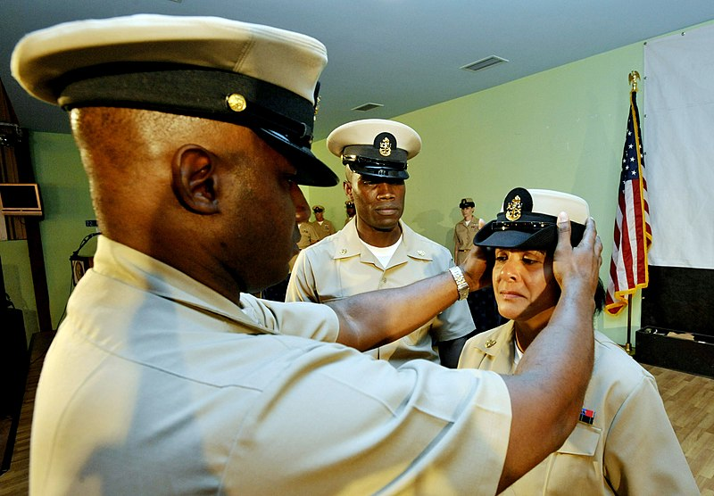 FileUS Navy 090916N0506A122 Senior Chief Yeoman Leo Godet places a combination cover on