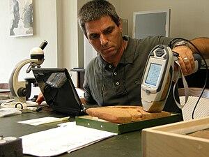 English: Y. Goren examining ancient cuneiform ...