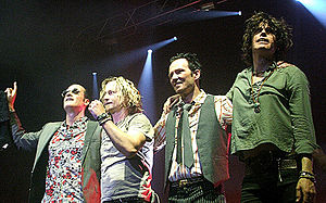 Stone Temple Pilots lined up on stage.