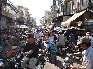 English: Busy street market on Chau Van Diep s...