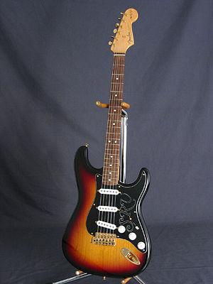 A Fender Stratocaster with sunburst finish, on...
