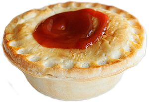 A typical Australian meat pie with tomato sauc...