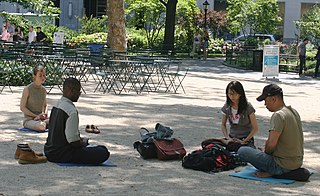 https://i0.wp.com/upload.wikimedia.org/wikipedia/commons/thumb/b/b2/Meditating_in_Madison_Square_Park.jpg/320px-Meditating_in_Madison_Square_Park.jpg