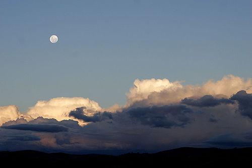 Moon over cumulus