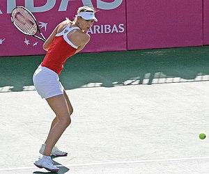 Maria Sharapova hitting backhand, Fed Cup matc...