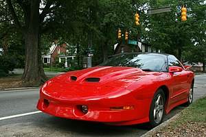English: Red Pontiac Firebird parked on Gregso...