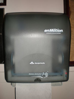 A Georgia-Pacific enMotion paper towel dispenser.