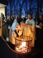 American Benedictine monks around an Easter fi...