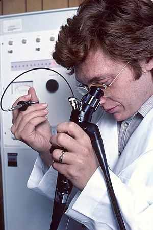 English: Pictured is a physician using a remot...
