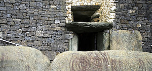 English: This is the entrance to the Megalithic Passage Tomb at Newgrange in Boyne Valley, Ireland. The top entrance, or 'roof box' entrance, is for the sun.