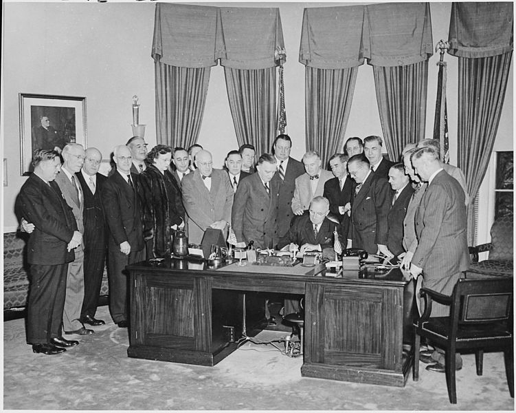 FilePhotograph of President Truman at his desk in the