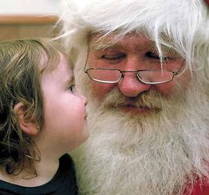Santa Claus with a little girl