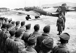 Erhard Milch addressing a Ju 87 staffel on a N...