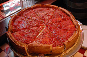 English: Chicago Style Pizza with a rich tomat...