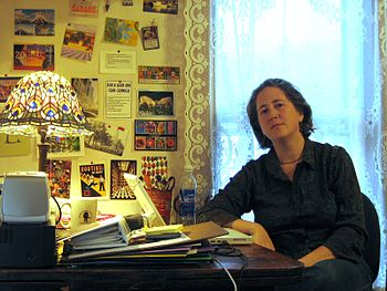 English: Jessamyn West at work in her office.