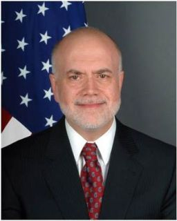 English: Scott H. DeLisi, U.S. diplomat. As of...