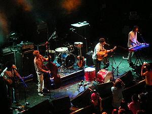 English: Photo of Mumford & Sons performing at...