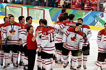 Canada forward Sidney Crosby celebrates with t...