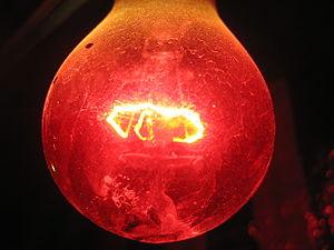 Red light buld in darkness