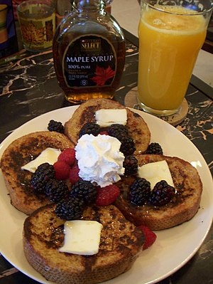 French toast, maple syrup, and orange juice. S...