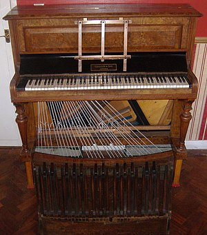 An upright pedal piano by Challen