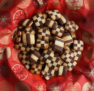 English: Christmas cookie checkered in black a...