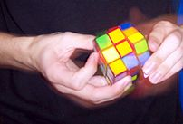 Image of speedsolving a standard 3x3x3 Rubik's...