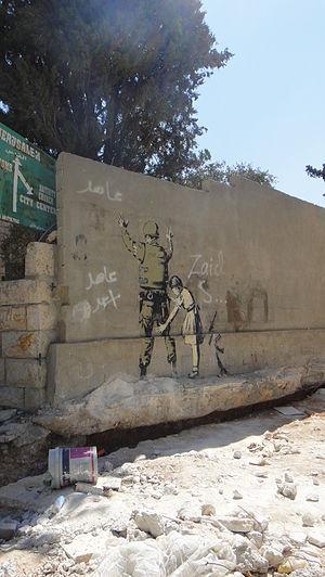 English: Painting of Banksy at Bethlehem.