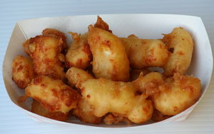 English: Cheese curds covered in beer batter a...