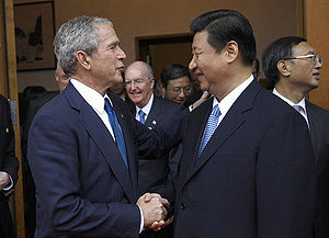 President George W. Bush is greeted by Chinese...