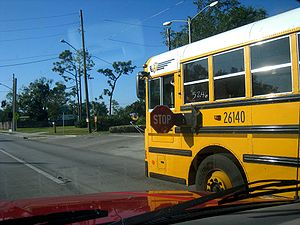 A photograph of a school bus with its stop arm...