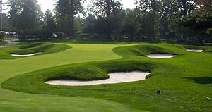 English: 18th Green The Championship Course at...