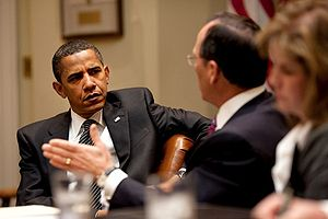 President Barack Obama listens to Safeway Pres...